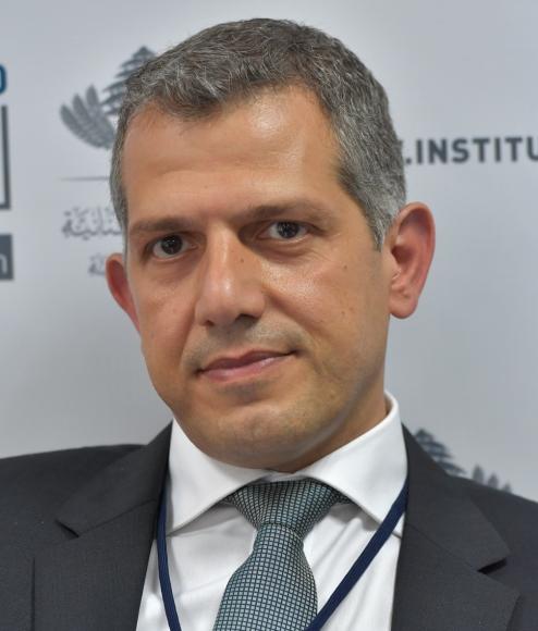 E. Naim